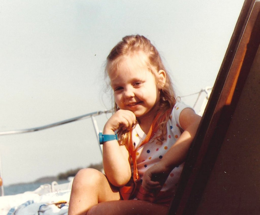 On our boat as a kid